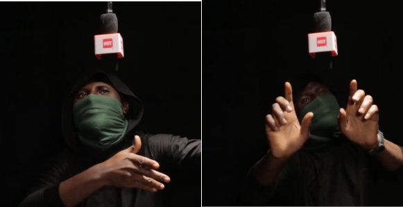 Masked Anonymous Nigerian Artiste Shades A-List Nigerian Artistes In Viral Song Titled SCAM (Video)