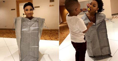 Tonto Dikeh Poses Inside A Ghana Must Go Bag; Says She Is Securing The Bag