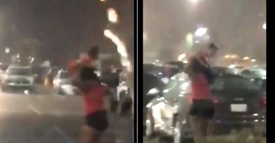 Women Caught Using Her Baby To Shield Her Artificial Weave From The Rain (Video)