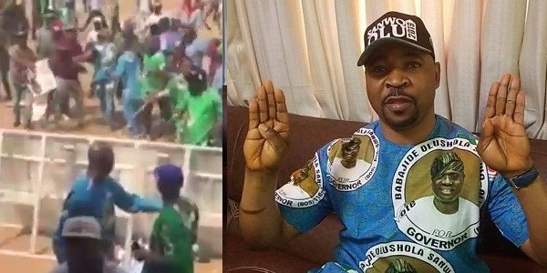 MC Oluomo Gushing Blood Shortly After He Was Stabbed In The Neck APC Rally (Video)