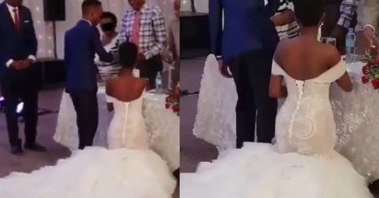 Photo Of Nigerian Bride Kneeling To Greet Guests At Her Wedding Causes Stir Online
