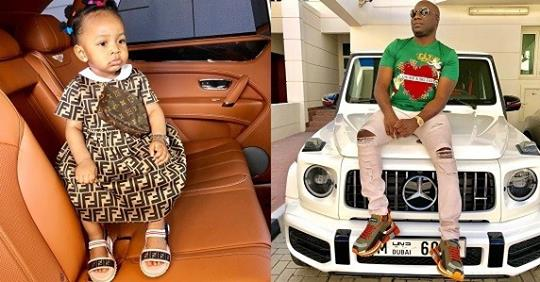 Mompha Shares Stylish Photo Of His Daughter Rocking Fendi Dress With Louis Vuitton Purse As She Clocks One