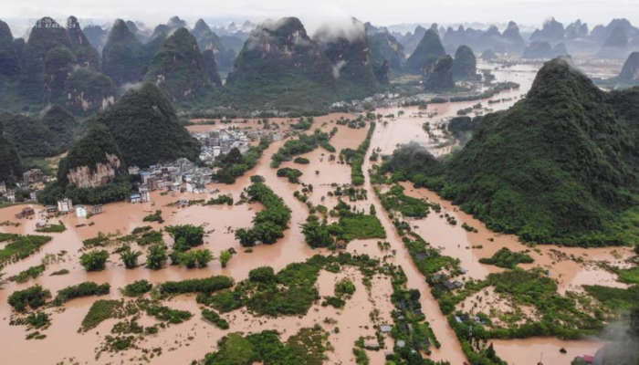 Dozens Killed And Thousands Displaced As Floods And Rainstorms Hit China  (Photos)