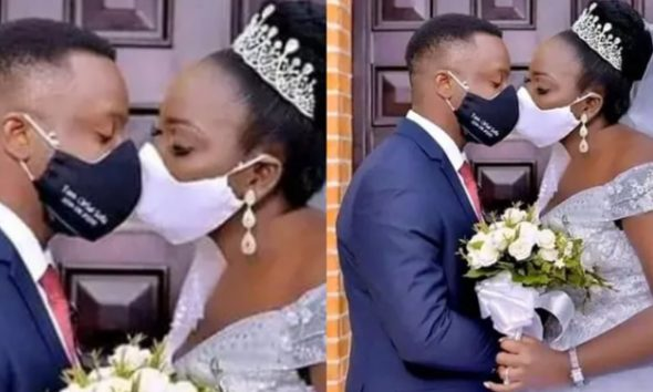 Nigerians Slam Newly Married Couple For Kissing With Face Masks On (Photo)