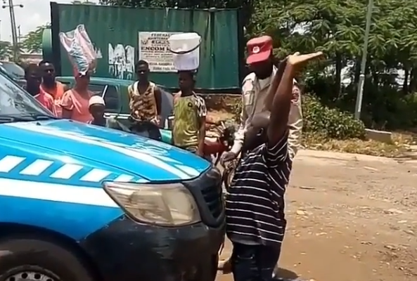 Knock Me Down – Man Says As He Kneels In Front Of An FRSC Van While Pleading For His License To Be Returned To Him (video)